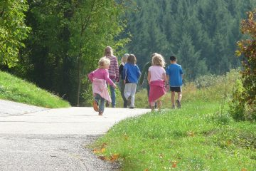family with children walking in the countryside