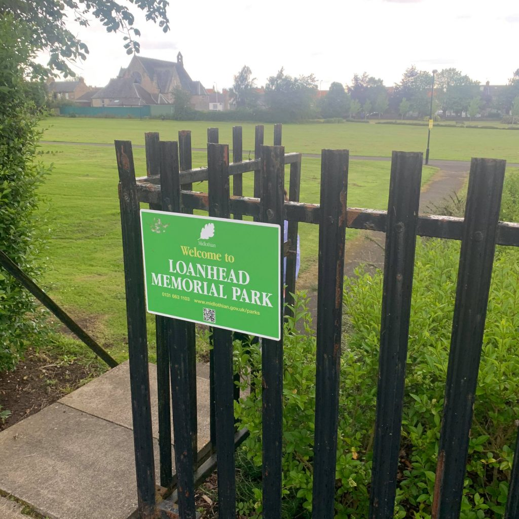 Sign on gate that says Loanhead Memorial Park